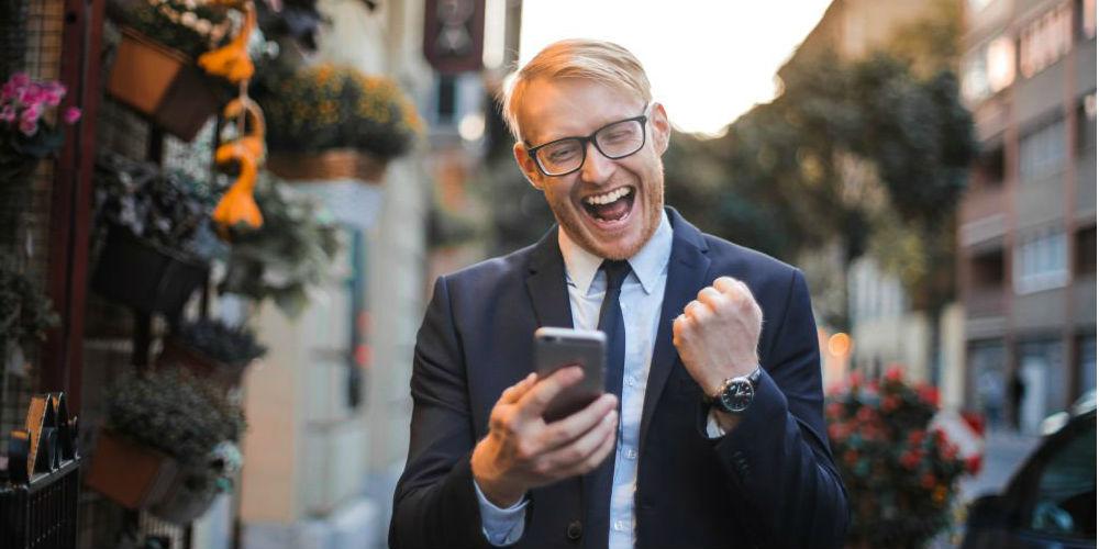 Happy customer looking at phone