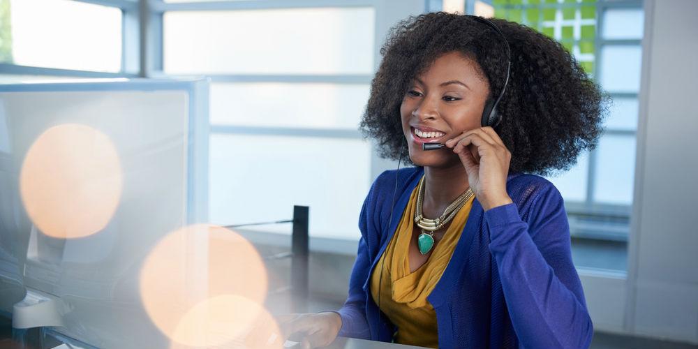 Customer service representative smiling on phone