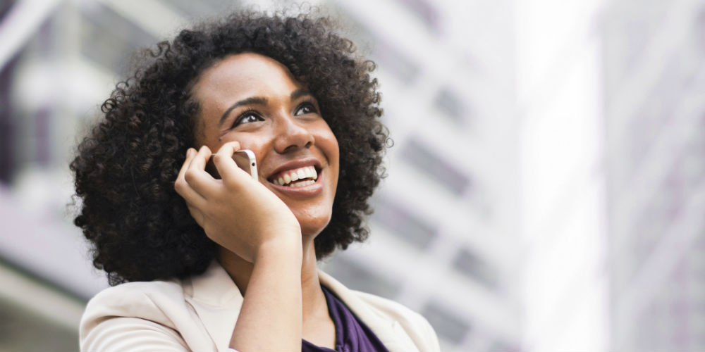 Happy customer on phone call with contact center